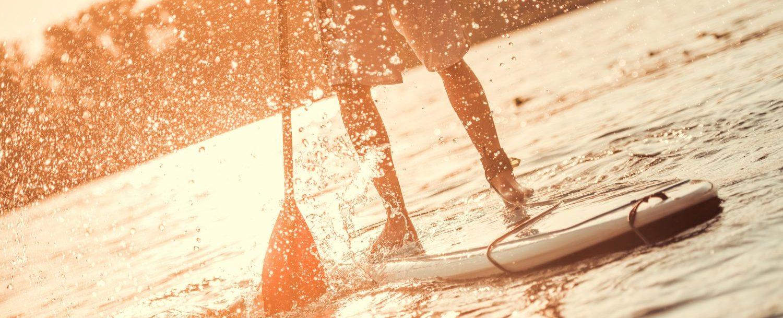 Man standup paddleboarding- Lake Wallenpaupack Paddle Board Rentals