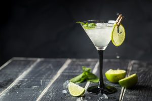Fresh classic lime margarita cocktail over black background